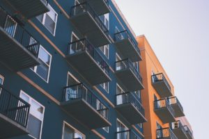 blue and orange apartment buildings with balconies affected by covid-19 real estate law