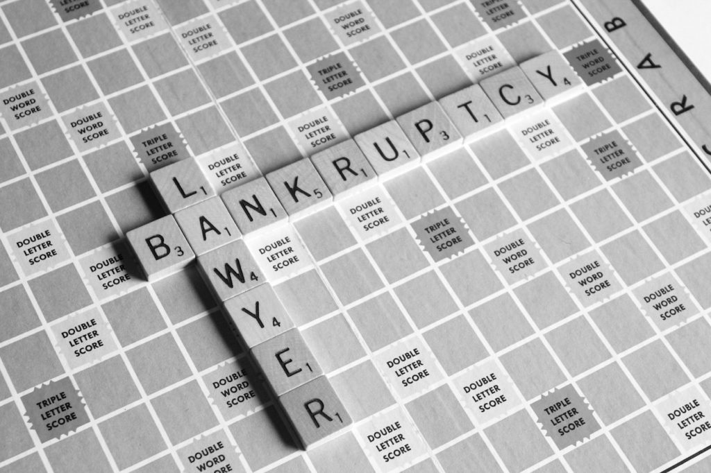 scrabble tiles spell out bankruptcy lawyer in black and white