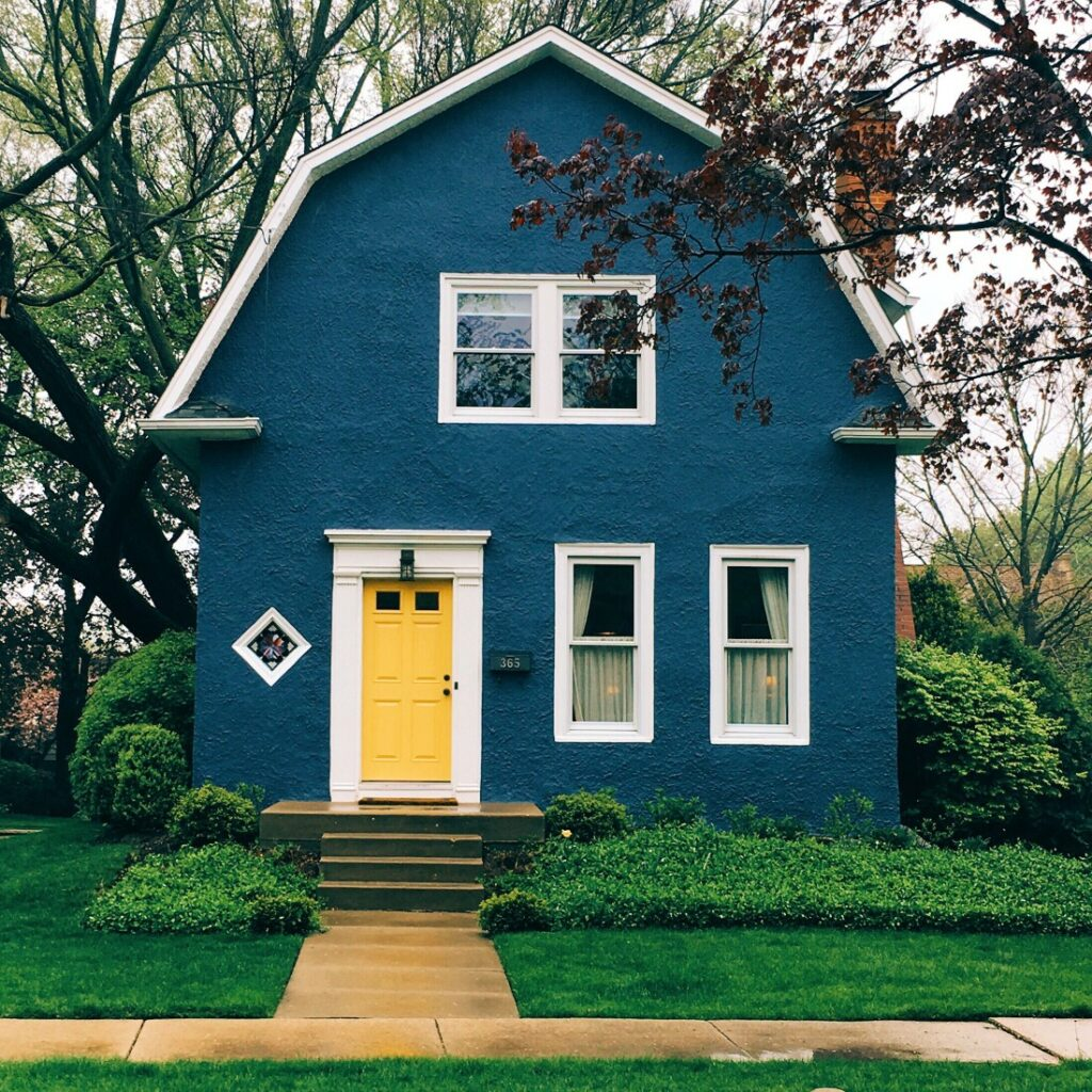blue house with yellow door--how foreclosure affects credit
