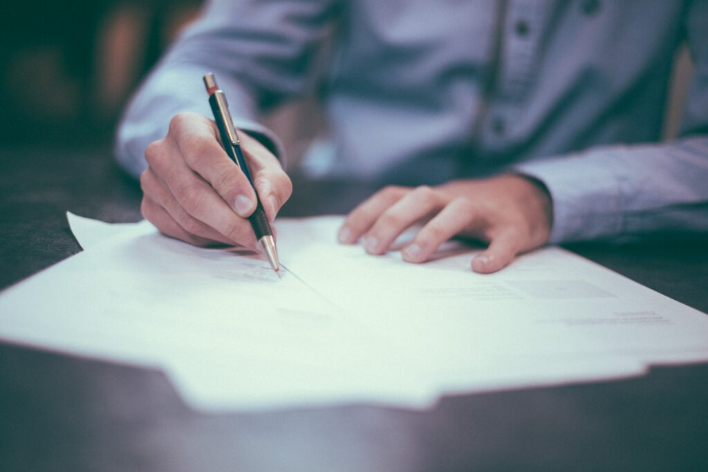 legal options for job loss in California - man signing documents
