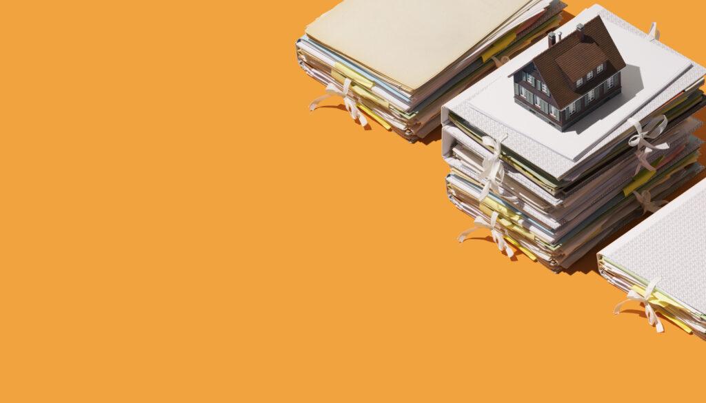 common types of real estate fraud - full binders on orange background